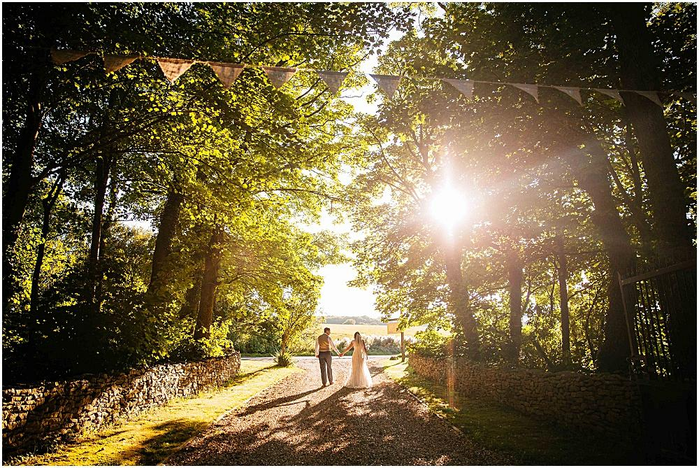 Bride and groom in setting sun