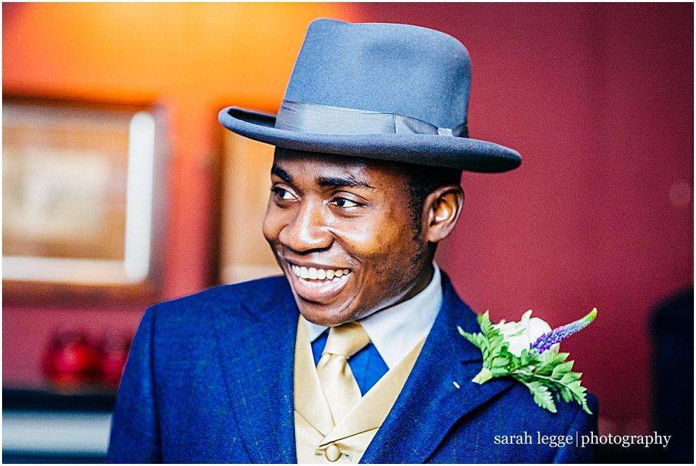 Handsome groom in hat