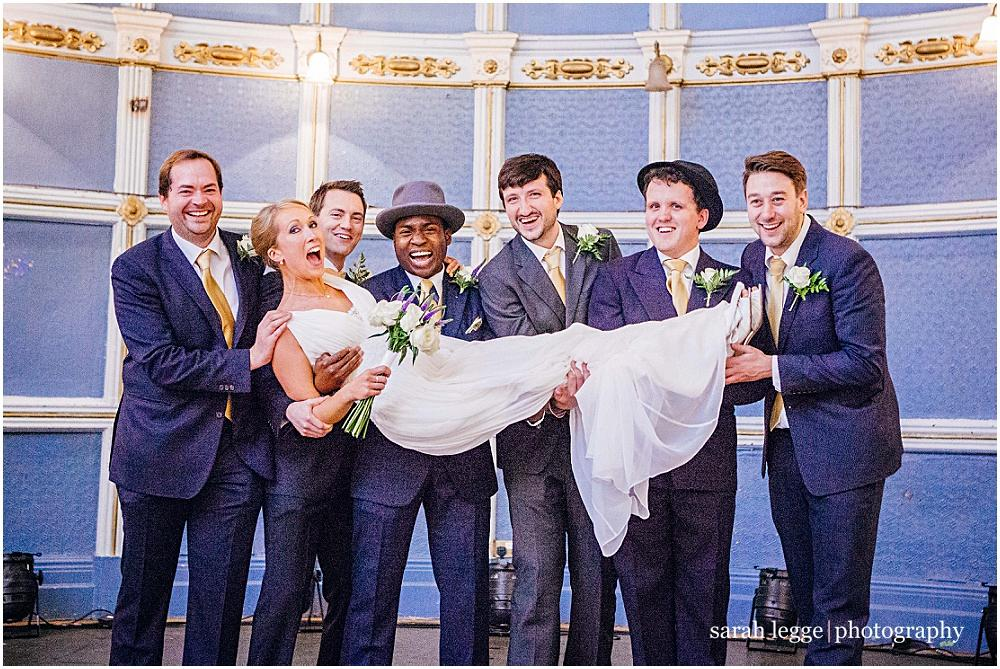 Ushers holding bride