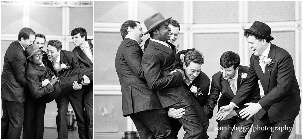 Ushers carrying groom