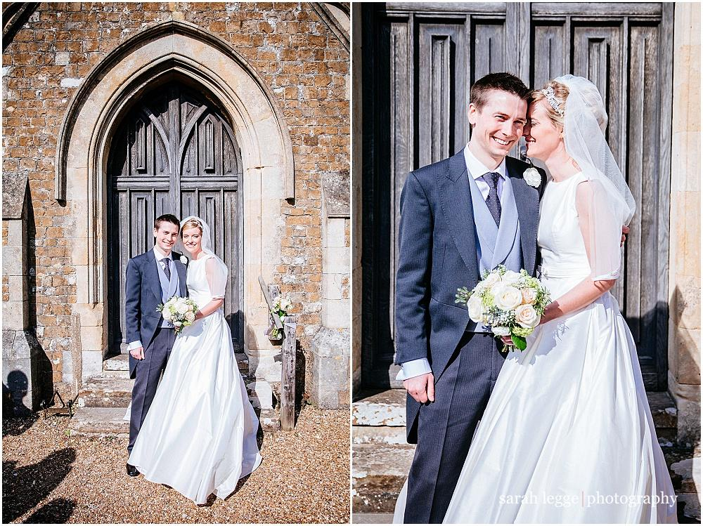 Lovely bride and groom in church doorway