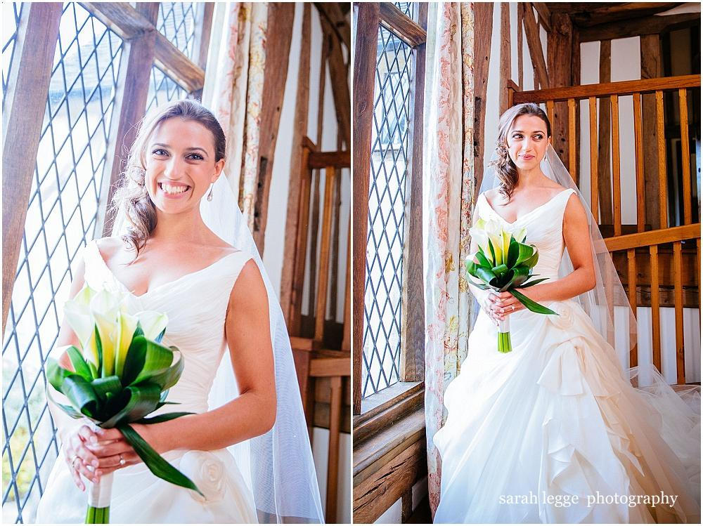 Bride by window with lilly bouquet