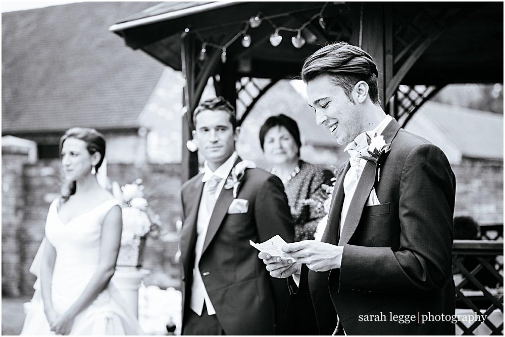 Brother reading during outdoor ceremony