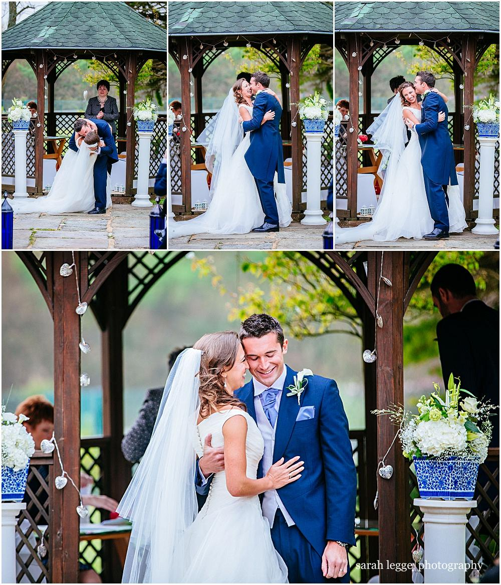 Groom dips his bride during the first kiss