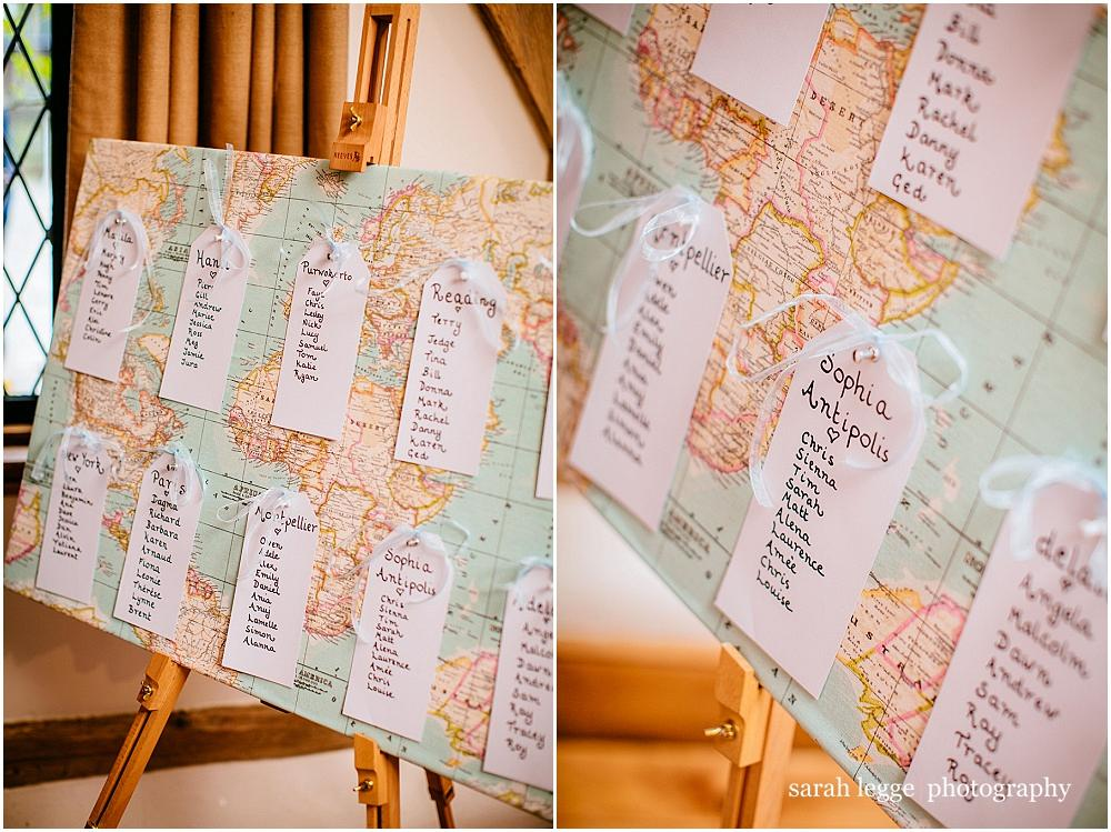 World map wedding table plan with luggage tag detail