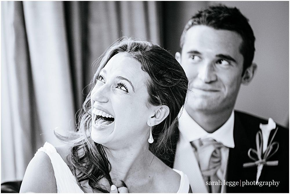 Bride laughing at fathers speech