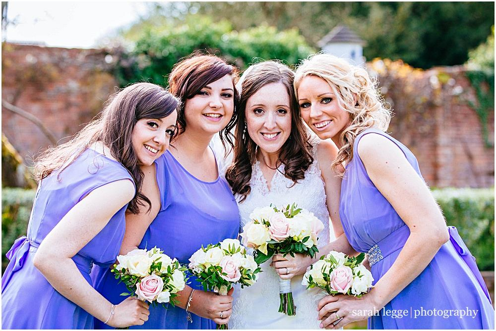 Bridesmaids in purple dresses