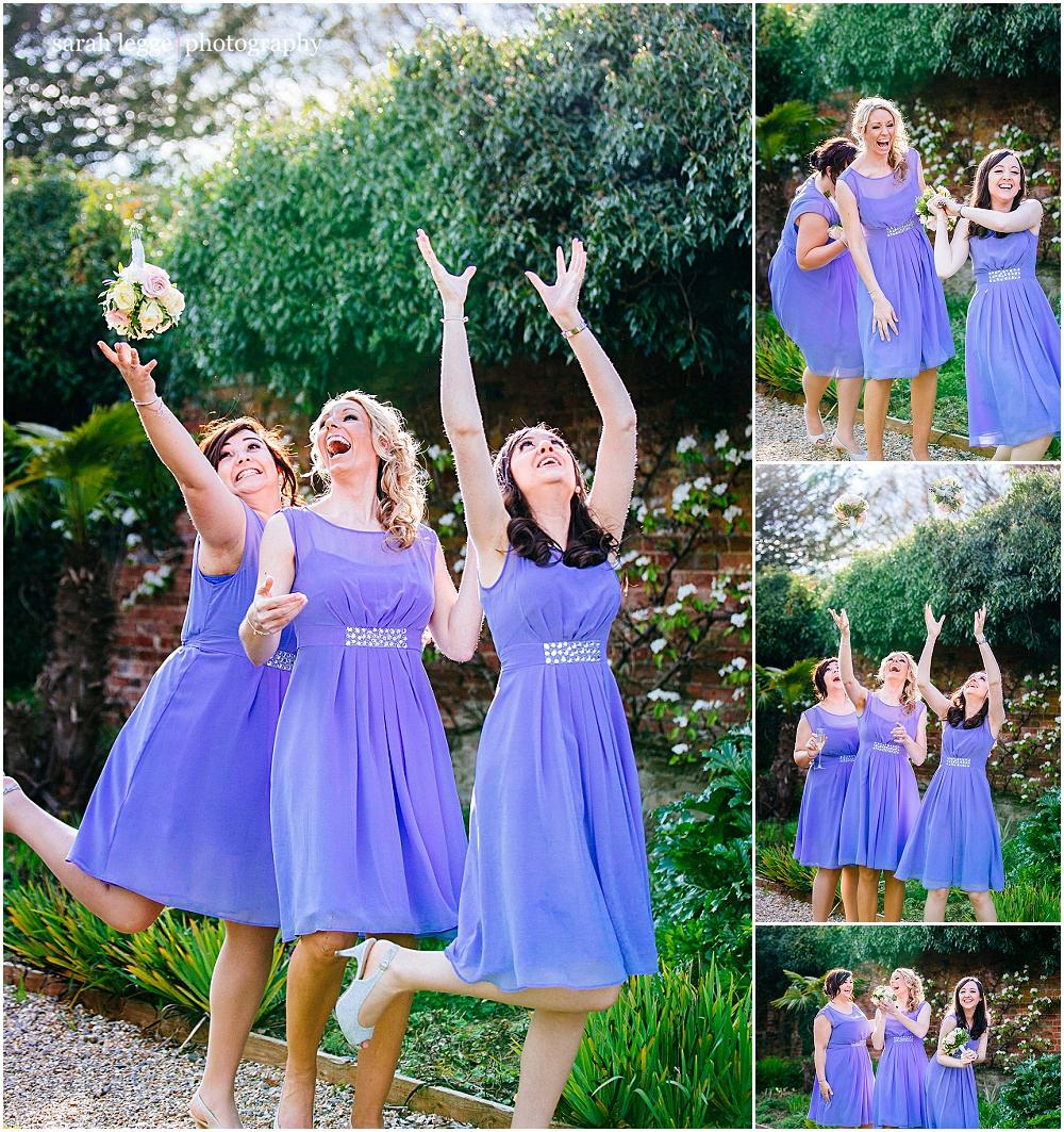 Bridesmaids messing about with bouquets