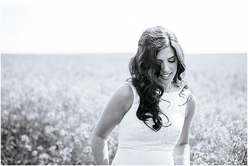 Stunning bride walks through field