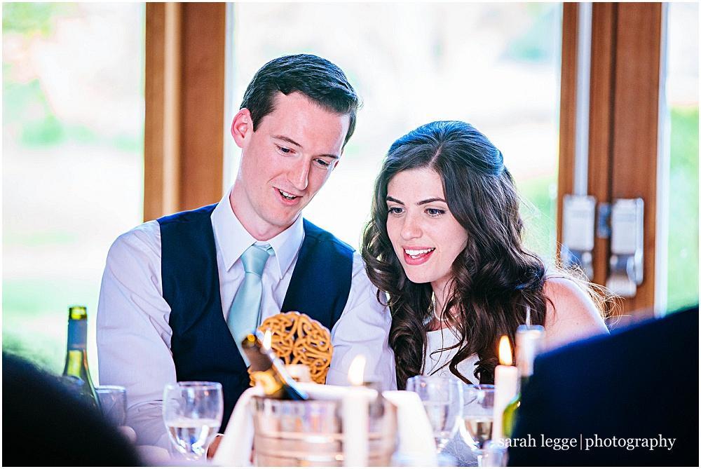 Newlyweds looking at wedding love spoon Welsh