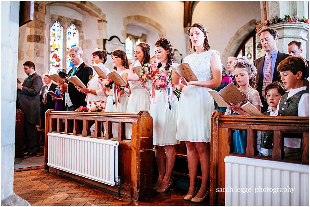 Pretty bridesmaids singing in church