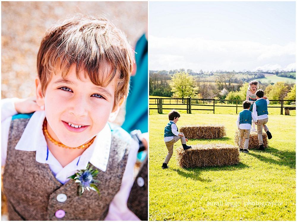 Kids playing on hay bales