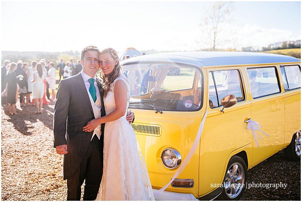 Bride and groom and camper van