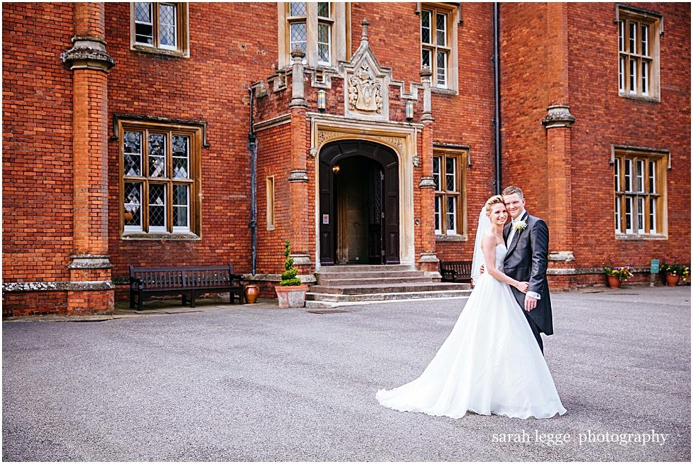 Bride and groom outside latimer place