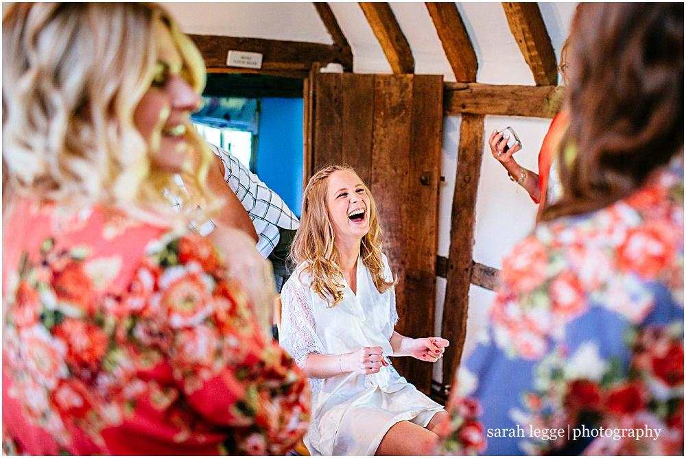 Laughing bride and cath kidston dressing gowns