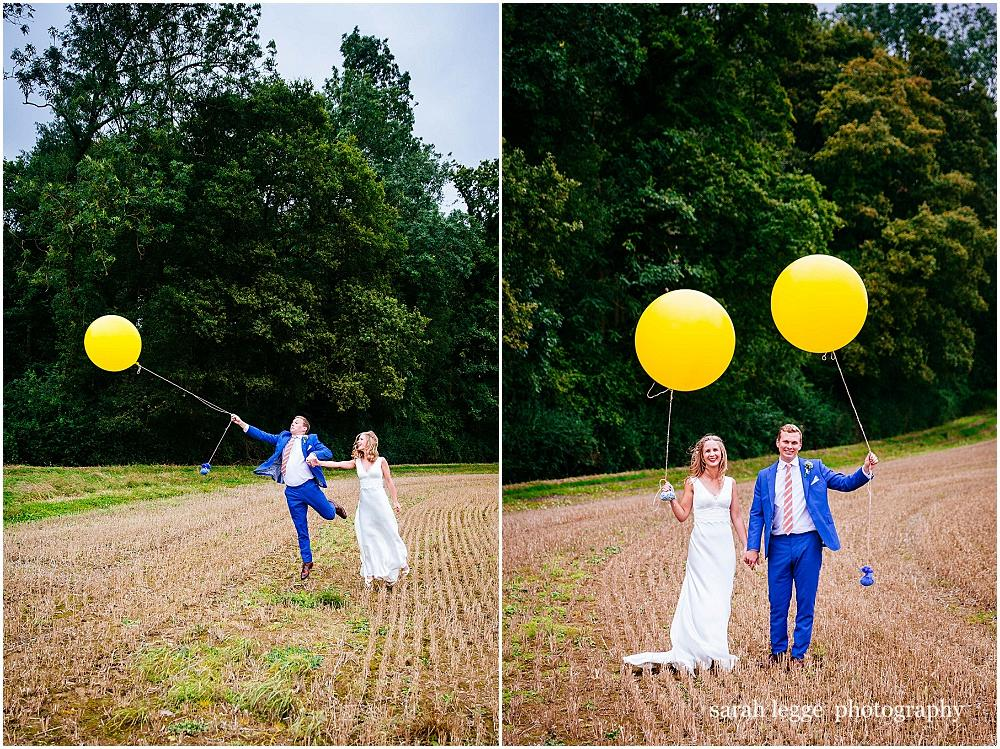 Bride and groom and big balloons