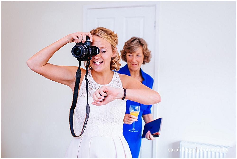 Bridesmaid with camera