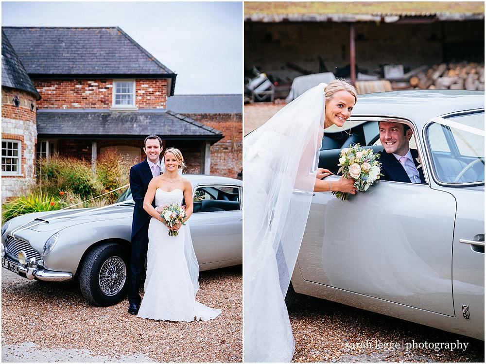 Wedding couple with aston martin at bury court barn