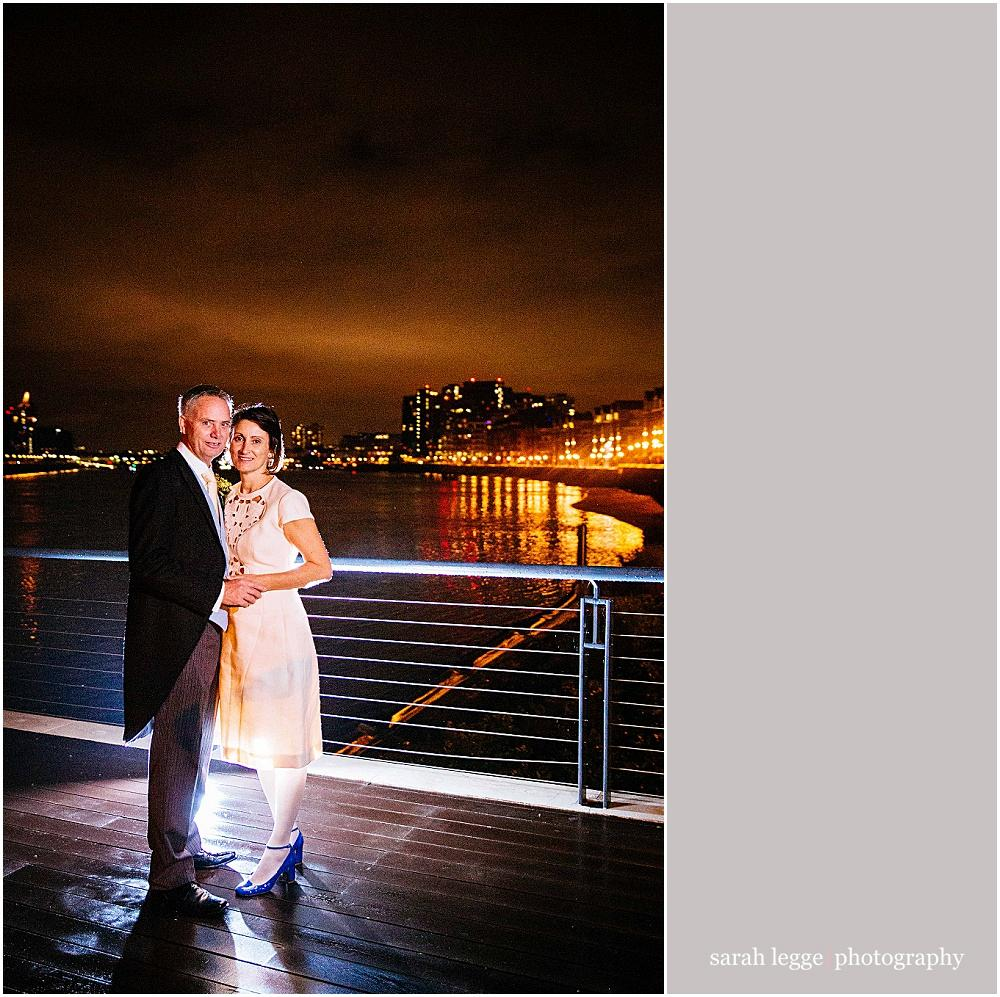 Bride and groom by Thames in Wandsworth