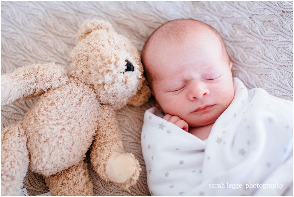 Tiny baby and teddy