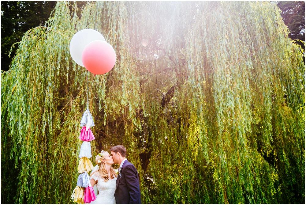 Bride and groom and big balloon