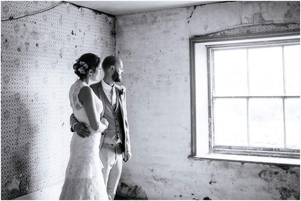 Wedding portrait in derelict room