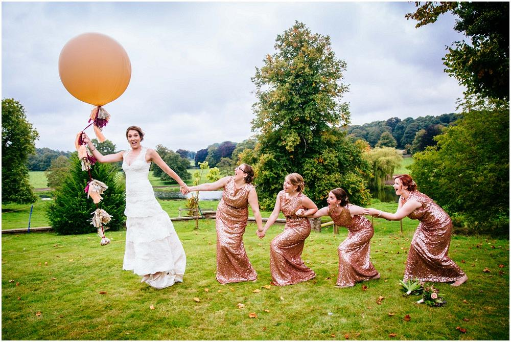 Bride taking off with big balloon