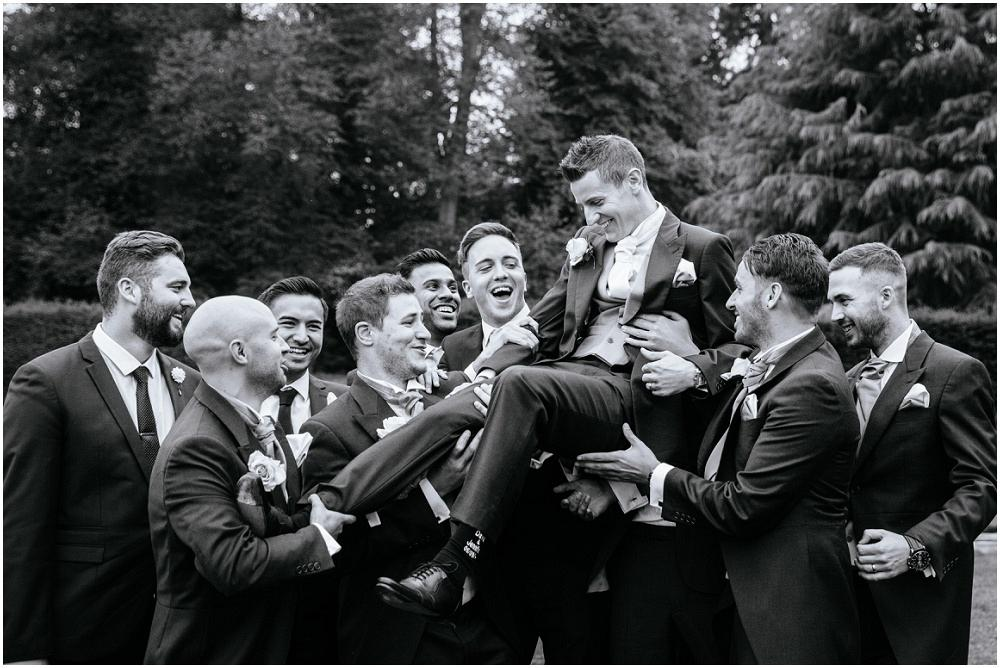 Lifting up the groom at capel manor