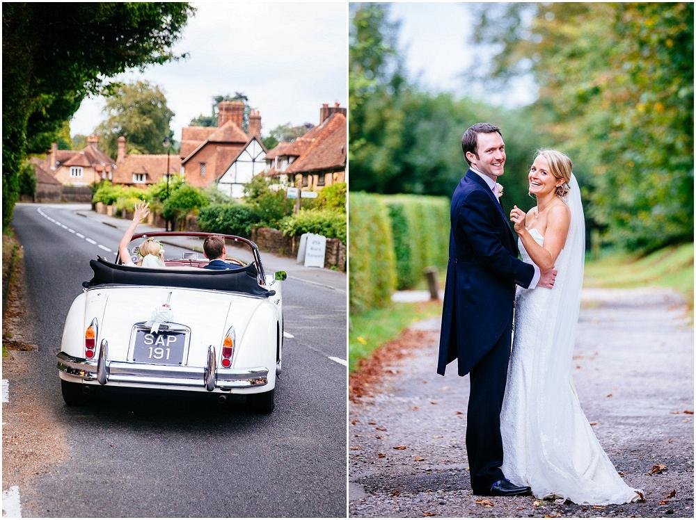Bride and groom laughing at bury court surrey