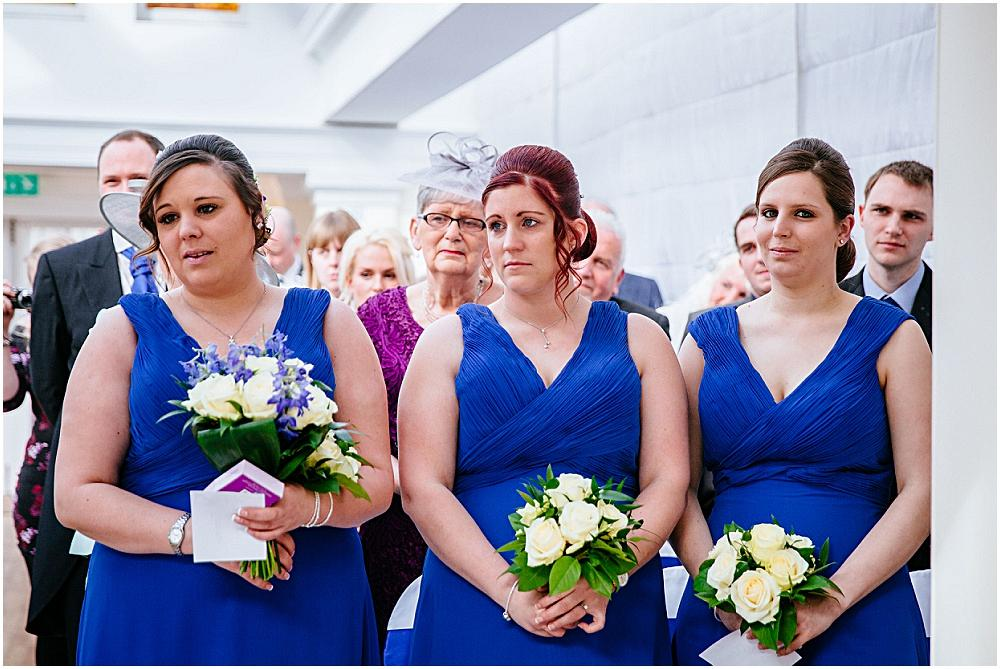 Emotional bridesmaids in blue