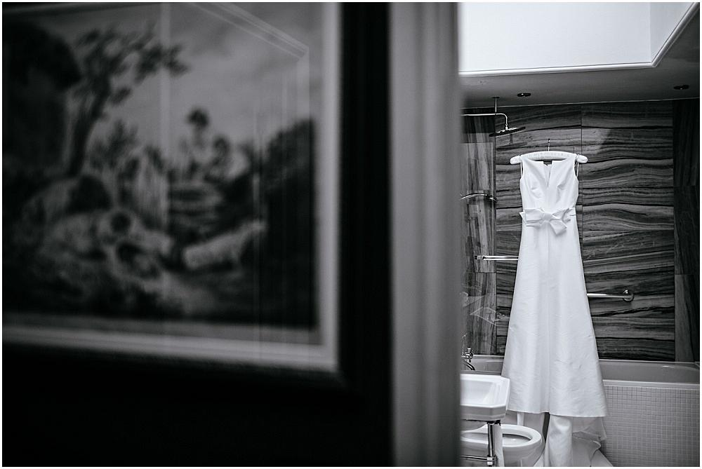 Wedding dress in bathroom