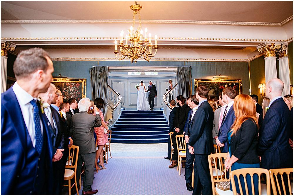 Bride walking down aisle at Savile Club wedding
