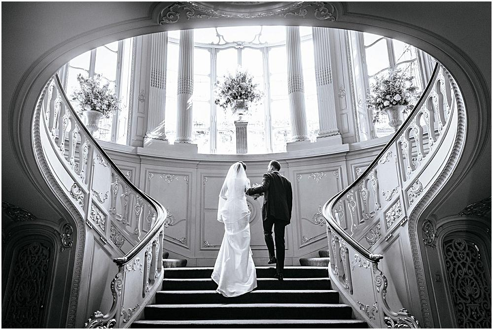 Stunning Savile club staircase bride and groom
