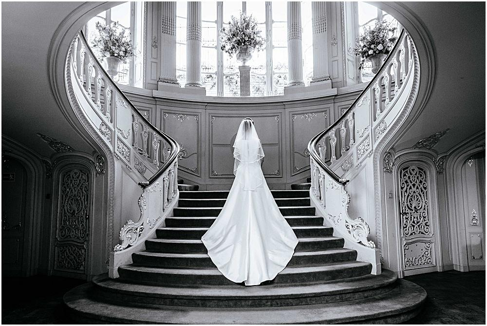 Brides train on Savile clubs stairs