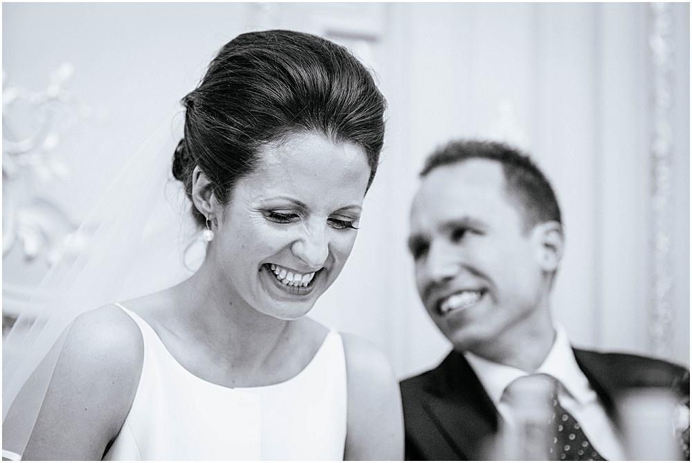 Laughing bride and groom at london wedding