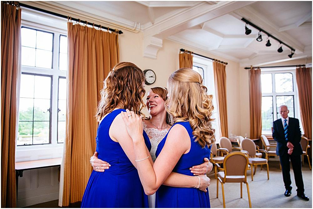 Bride hugging bridesmaids