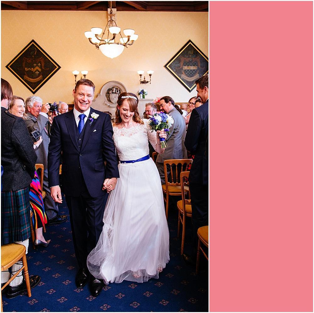 Triumphant bride walking back down aisle