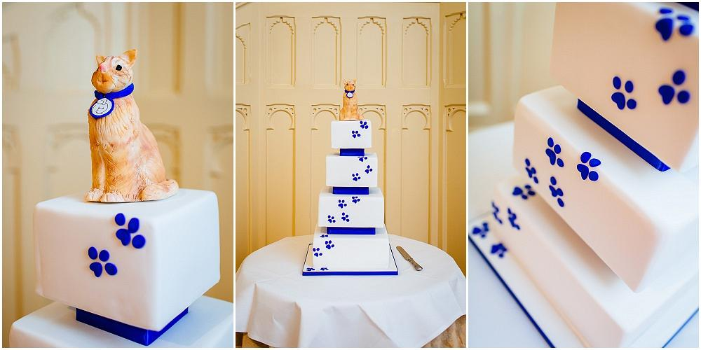 Blue wedding cake with cat on