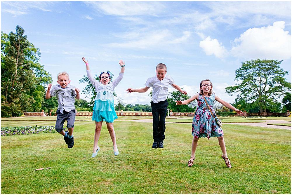 Children jumping at wedding