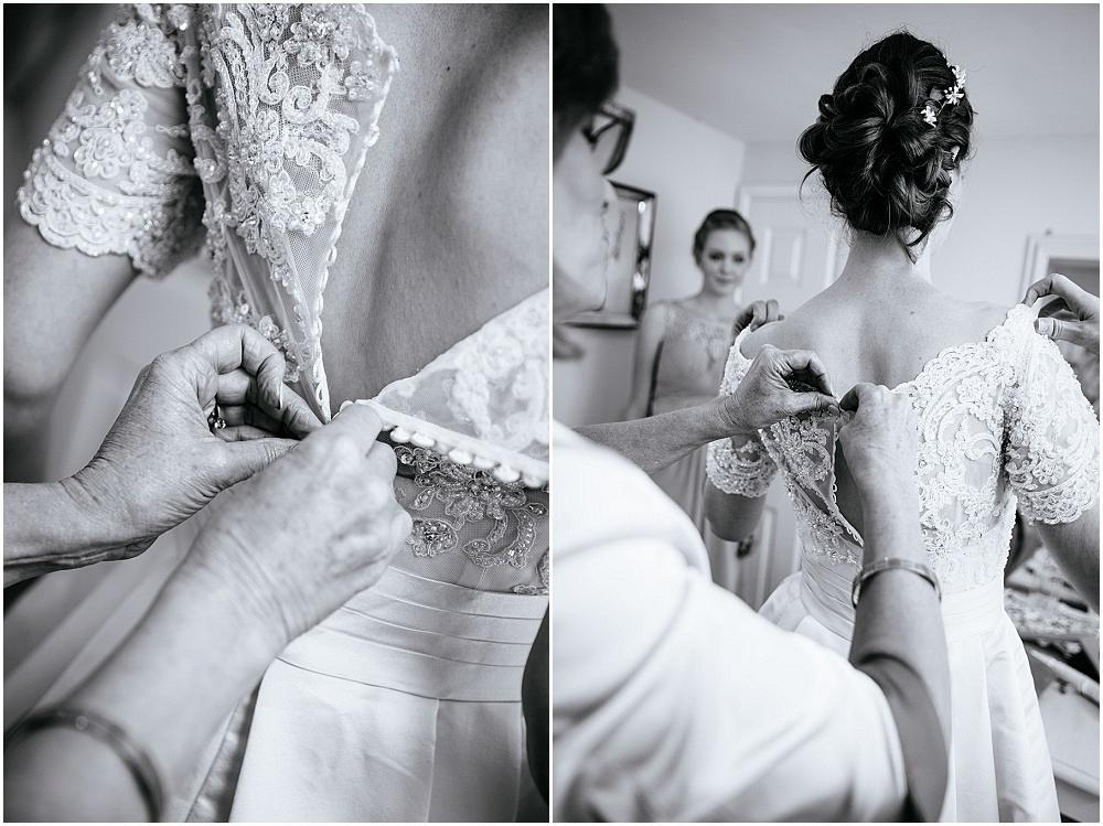 Brides buttons being done up
