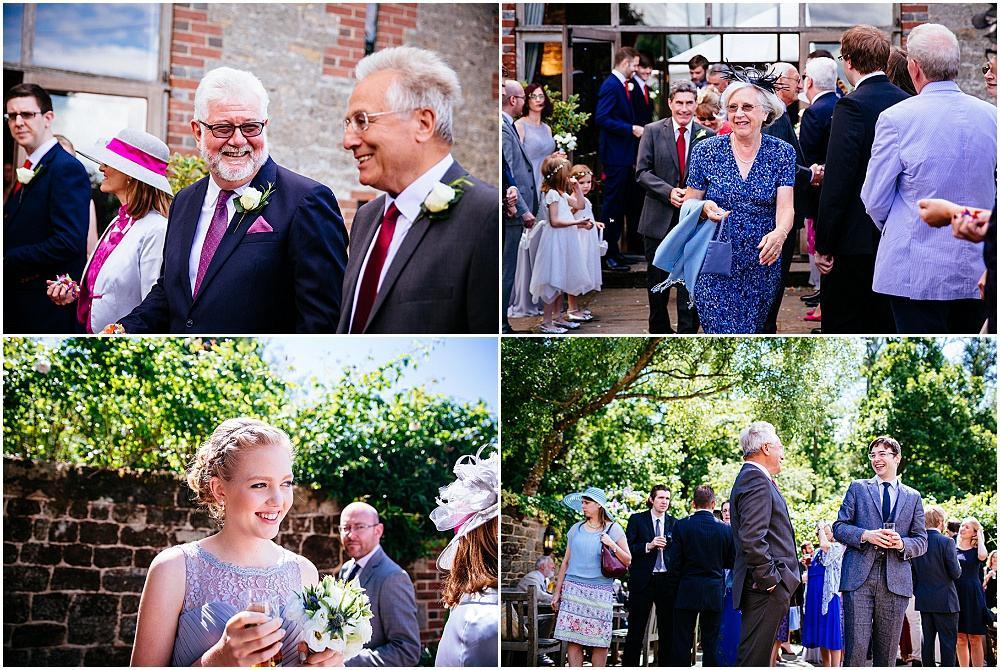 Happy wedding guests at sunny bartholomew barn wedding