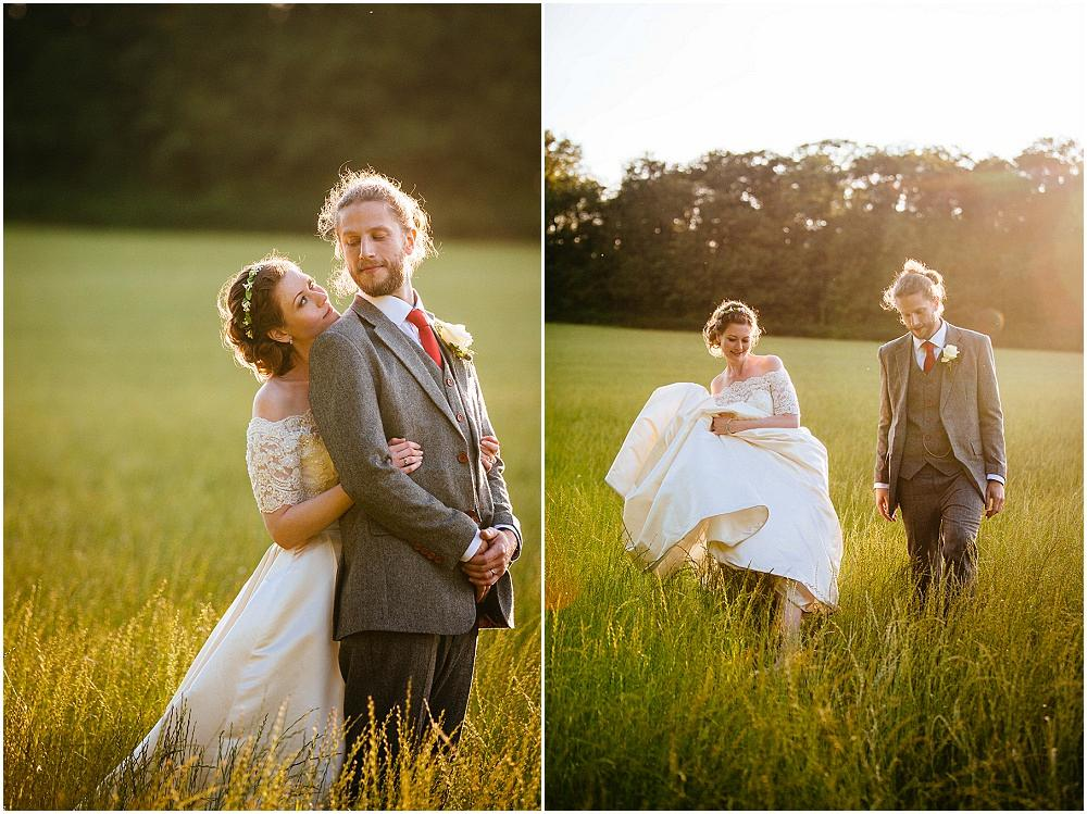 Bride and groom in field