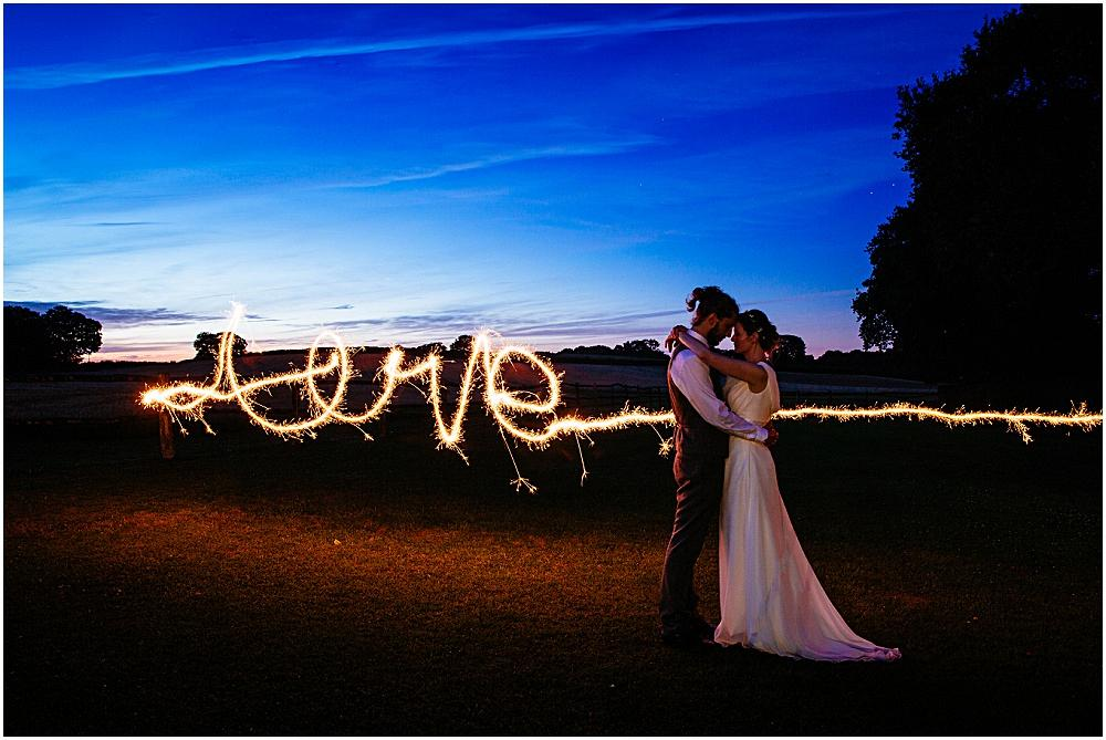 Love written with sparklers at wedding