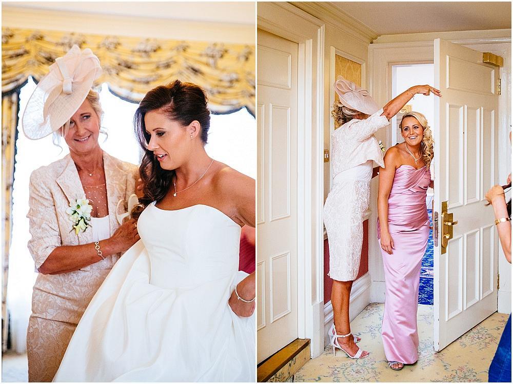 Bride getting zipped into wedding dress