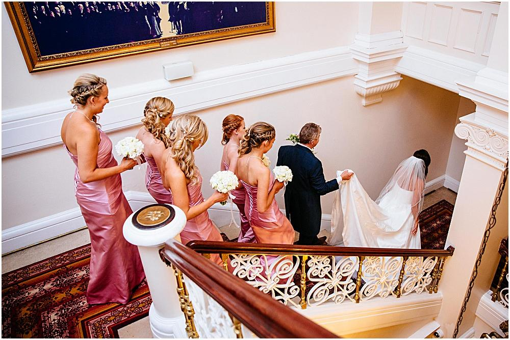 Down hall stairs with bride on