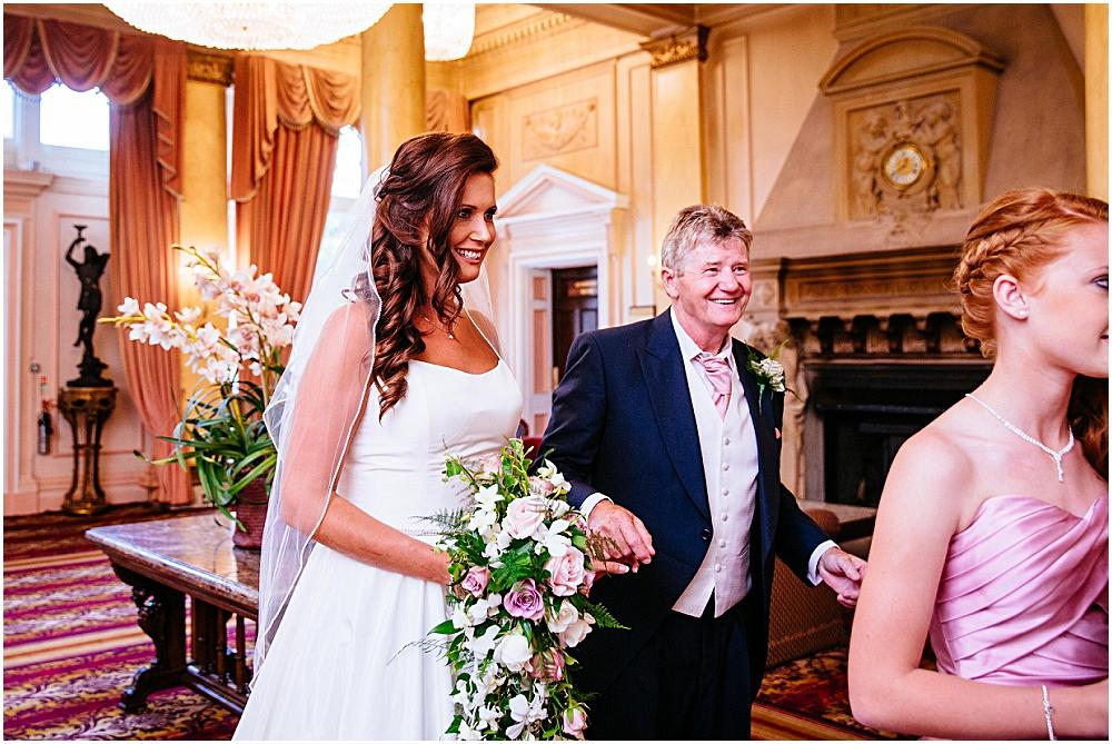 Bride and father waiting for down hall wedding ceremony