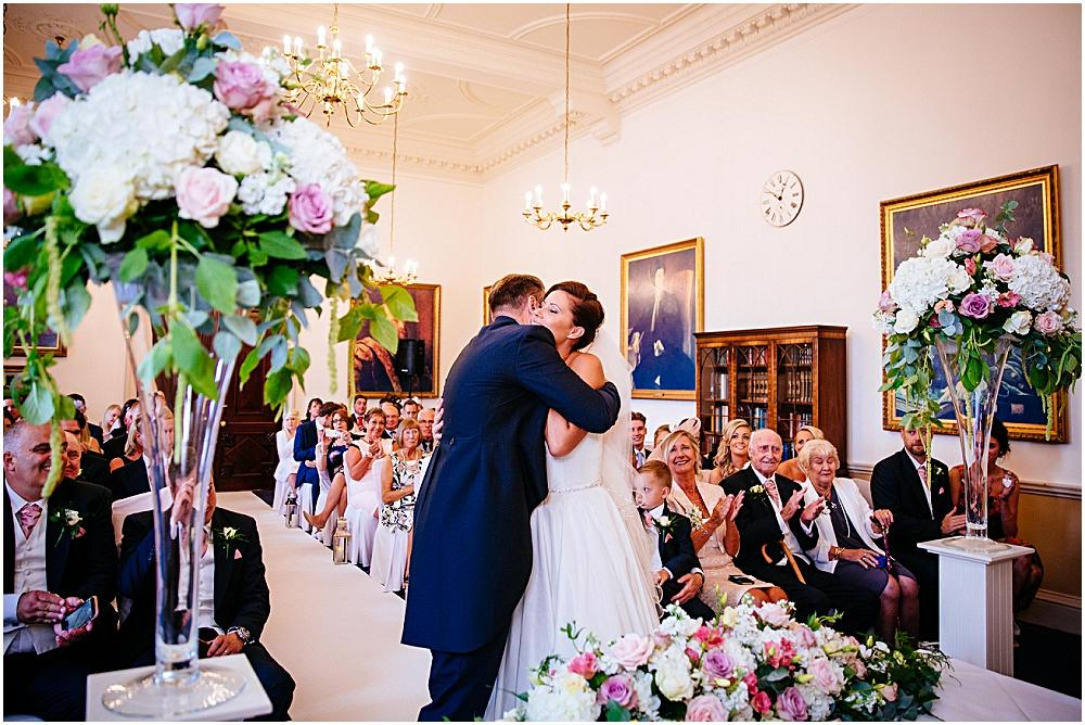 Bride and groom hug after Essex wedding ceremony