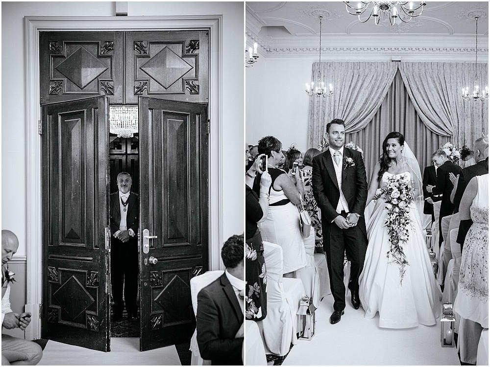 Bride and groom walking back down Down Hall aisle