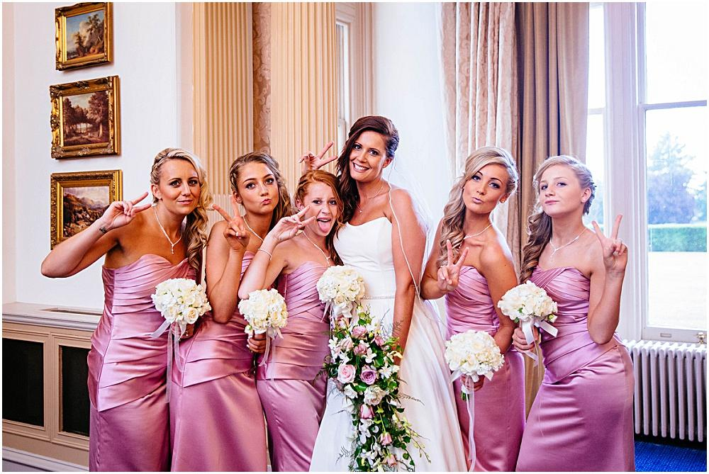 Bride and young bridesmaids striking a pose