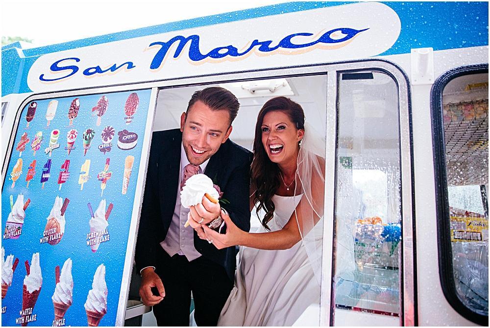 Bride and groom laughing in ice cream van